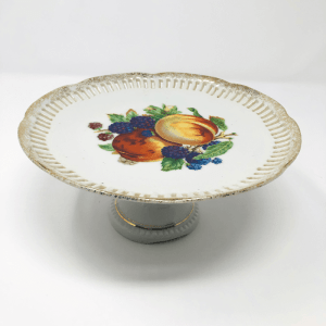 white cake stand with painted fruit