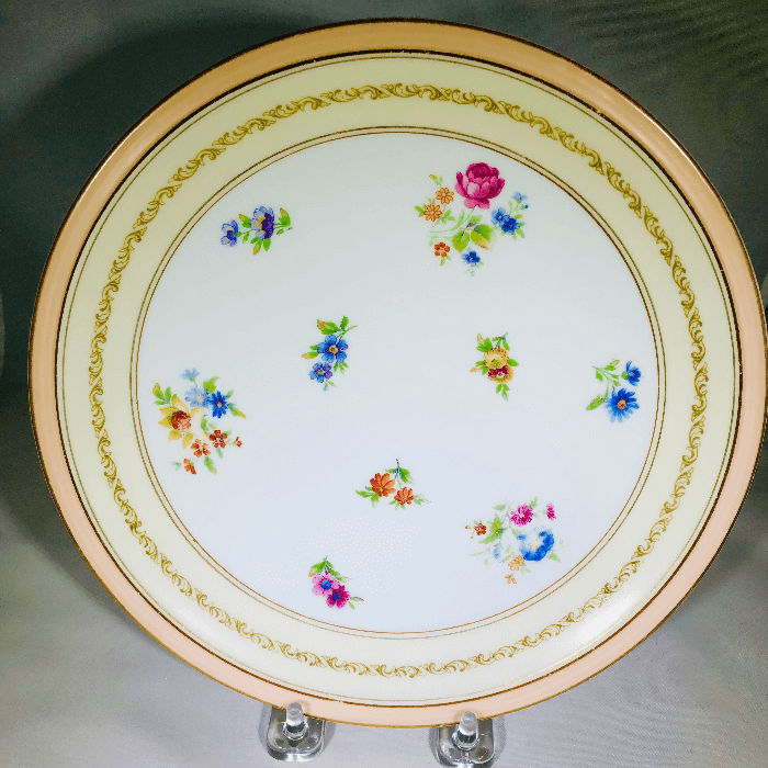 close up of a pink and white Limoges Plates