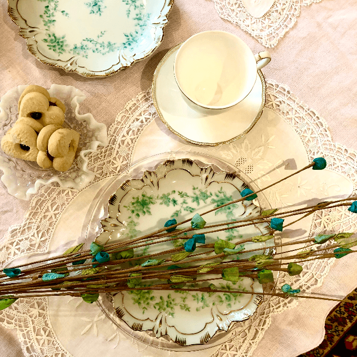 Blue Silk Flowers on a white and turquoise plate