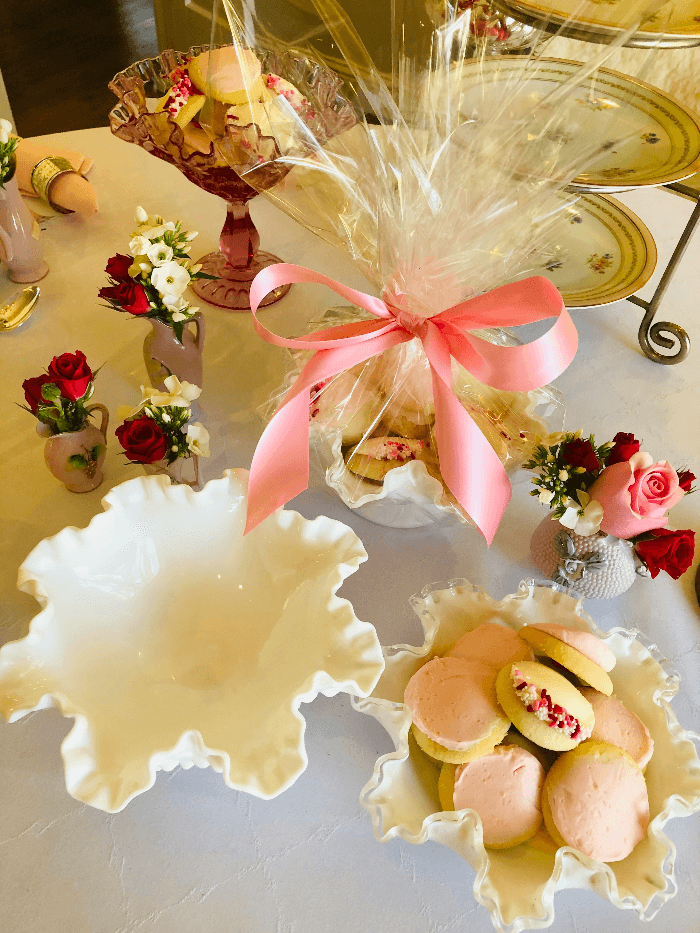 white dishes filled with pink cookies