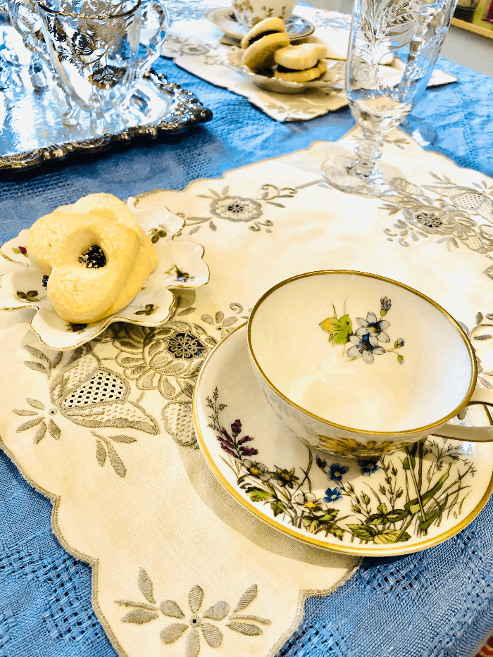 a tea cup and saucer decorated with wildflowers