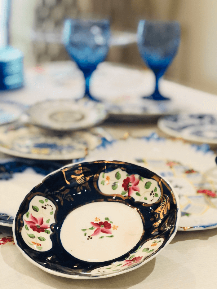 a blue and white and pink china plate