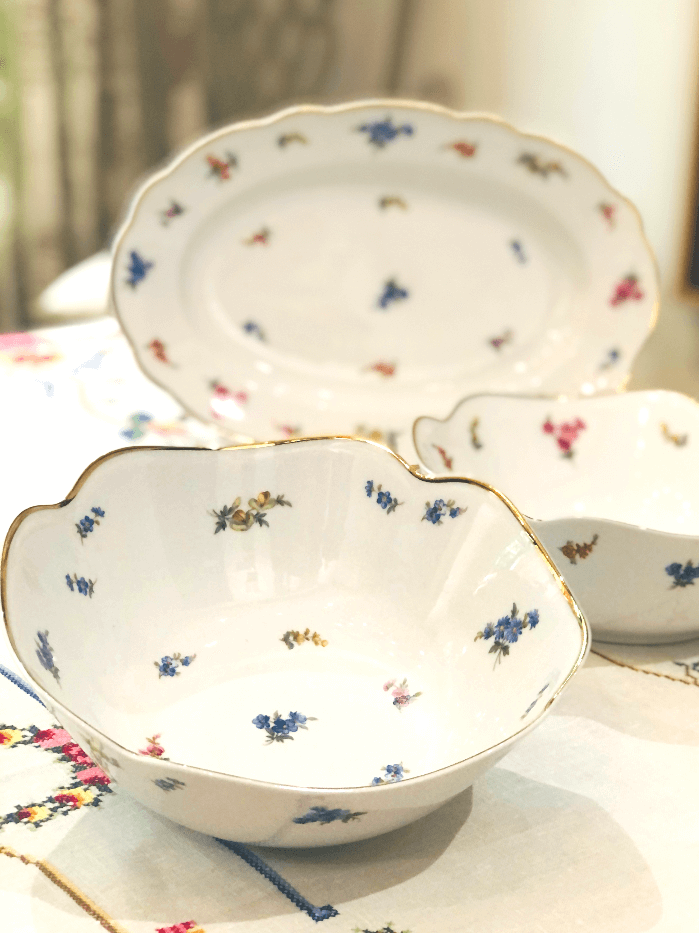 white china bowls and platter with blue and pink flowers