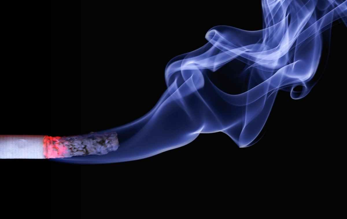 lighted cigarette stick and white smoke wallpaper
