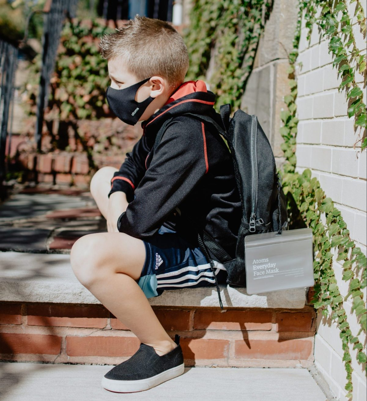 student with backpack wearing mask