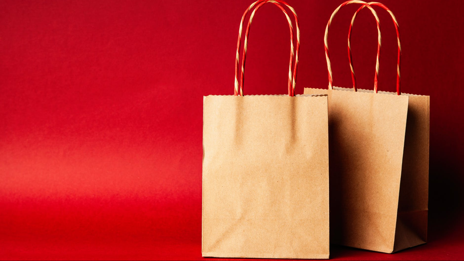 two shopping bags with red backgroud