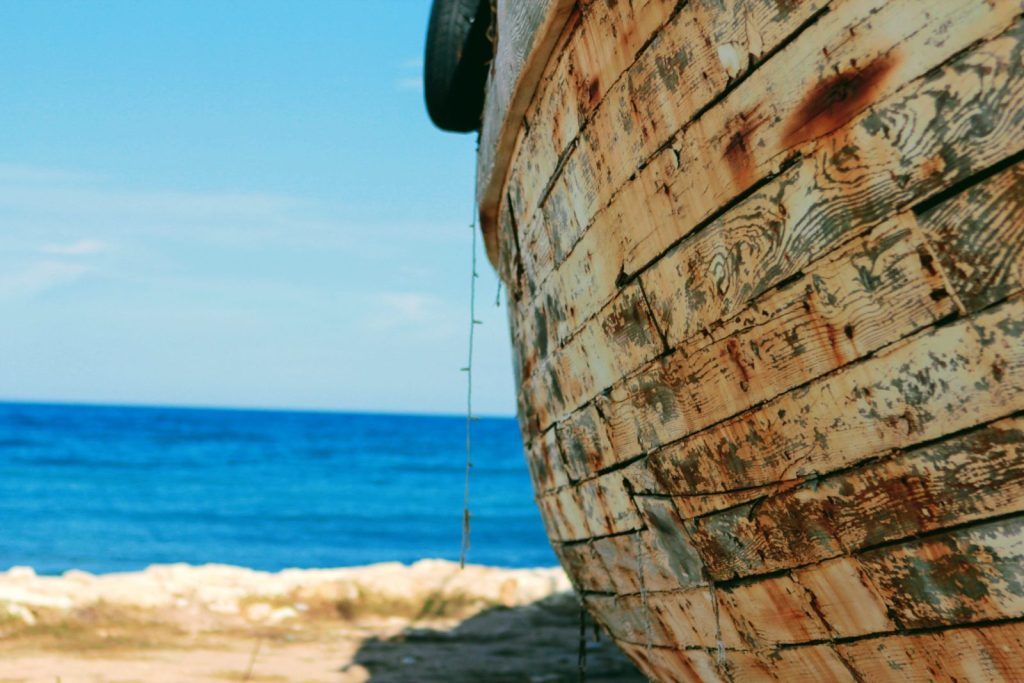 Small wooden boat, beached and abandoned