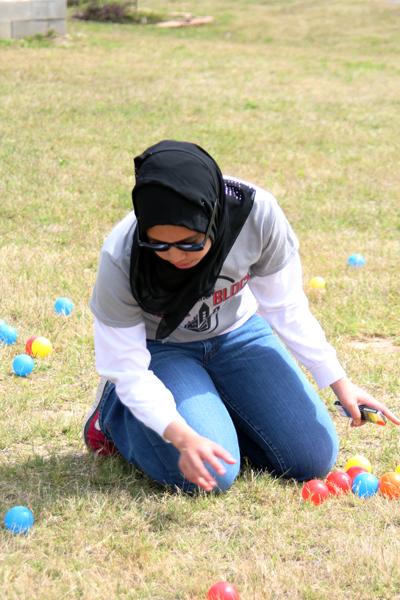 "Pre-pharmacy freshman Farhana Zabidi prepares the ""Clean your Room"" game for the neighborhood childiren. | Mahnoor Samana/The Daily Cougar"