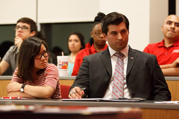 "After defending against complaints for falsifying financial documents, REDvolution party presidential candidate Charles Haston, center, and vice presidential candidate Erica Tat were found ""not guilty"" by the SGA Elections Trial Board. 