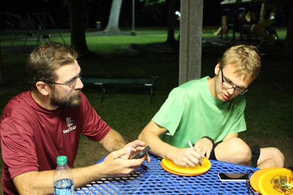 Cody Miller signs the record tying and breaking discs. | Nam-My Le/The Daily Cougar