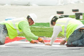 As the football season nears workers are determined to finish TDECU Stadium on time as they install the new turf. | Emily Chambers/ The Daily Cougar