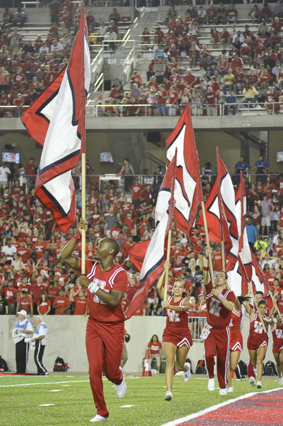 The UH crowd was welcomed to the stadium Staurday night by the cheerleaders as they worked to get everyone riled up. | Caitlin Hilton/The Cougar