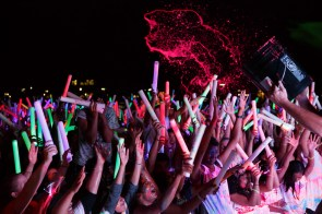 Students got buckets of neon paint thrown on them throughout the festivities. | Justin Tijerina/The Cougar