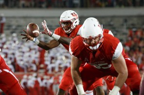 Junior quarterback Greg Ward, Jr., center, had a career night en route to the UH victory, as he complied six total touchdowns on the night.   Justin Tijerina/The Cougar