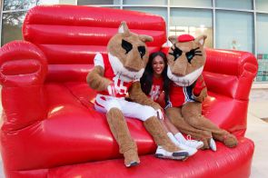 Hotel and restaraunt management major Asia Blanton posed with Shasta and Sasha on inflatables. | Photo by Justin Cross.