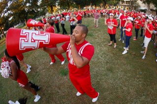 UH cheerleaders use a megaphone to get the crowd loud and proud.