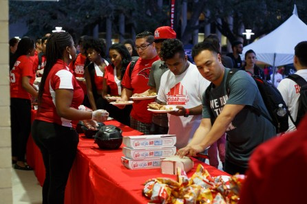 When hunger strikes, students wearing red were able to chow down on pizza, chips and more. | Photo by Justin Tijerina.