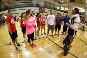 The Homecoming Court get briefed on the rules of floor hockey Wednesday night. |Photo by Justin Tijiera/The Cougar.