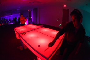 Students play arcade style games at the silent disco homecoming event. | Photo by Justin Tijiera/The Cougar.