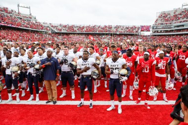 After the game, the Cougars joined the Midshipmen in the West end zone for the singing of Navy's alma mater on November 29, 2015. | Justin Tijerina/The Cougar