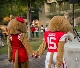 Shasta and Sasha hold hands during the pep rally.