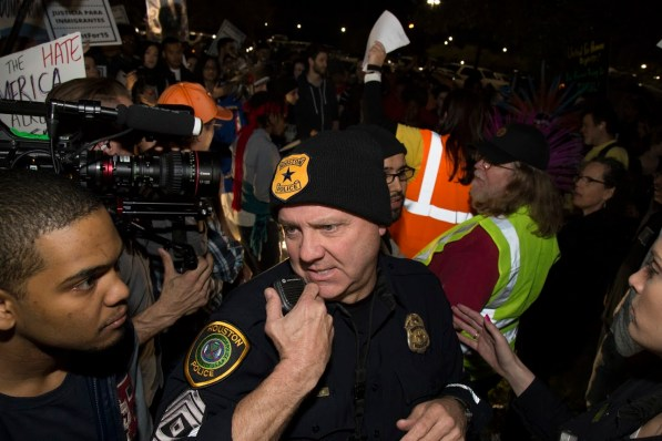 HPD worked to keep the protesters under control as the night went on. | Photo by Justin Cross.