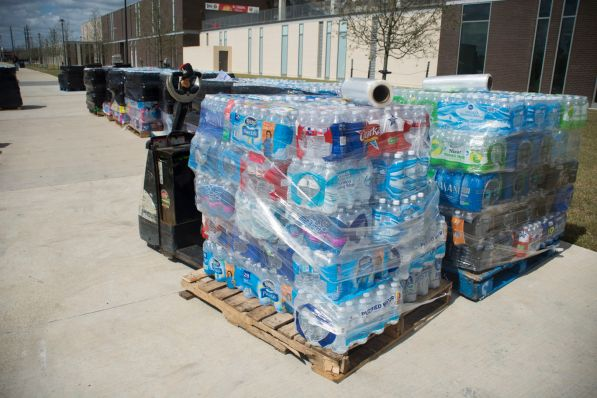 Dozens of bottled water cases were donated on Friday morning which will be delivered to aid Flint, Michigan.   Justin Cross/The Cougar