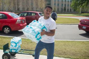 Calen Reed volunteered his time by transporting case after case while in the drive.   Justin Cross/The Cougar