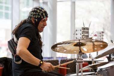 Guillermo Reza, percussion, plays while being monitored at Tuesday's event.   Justin Tijiera/The Cougar