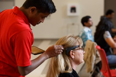 Audience members get ready to see how music affects their brain-wave movements. | Justin Tijiera/The Cougar
