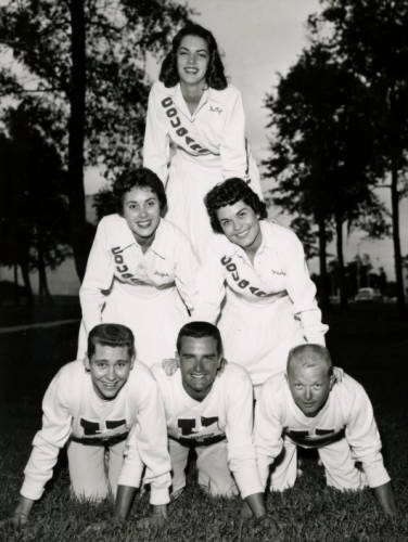Judy Morris (top) and Jan McMullen (center left) and four other unidentified cheerleaders made cheerleader triangle.   Courtesy of UH