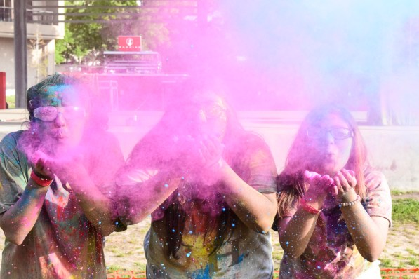 Psychological, health and learning sciences senior Jessica Sunny, communications senior Susan Moosavi and a friend celebrate at the Council of Ethnic Organizations' annual Holi festival. | Robyn Archer/The Cougar
