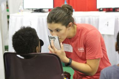 Since many elementary students can and do fall through the cracks when it comes to vision testing, free tests at the Back 2 School Fest proved vital. | Emily Burleson/The Cougar