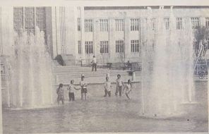 The Reflection Pool between Ezekiel Cullen and the Education Building was filled Thursday and the fountains were turned on. Several students took advantage of the cool water to relieve themselves of the heat.   Taken from The Cougar, 1972