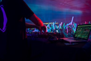 Typically, students are sprayed with neon body paint as they dance at Glow Party, but since the event was held indoors, they stuck to glow sticks and hats. | Justin Cross/The Cougar