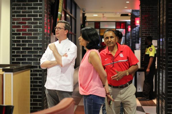 Chartwells District Manager David Riddle welcomes President and Chancellor Renu Khator and her husband, professor of industrial engineering Suresh Khator, at a dining hall Saturday for lunch.   Thomas Dwyer/The Cougar
