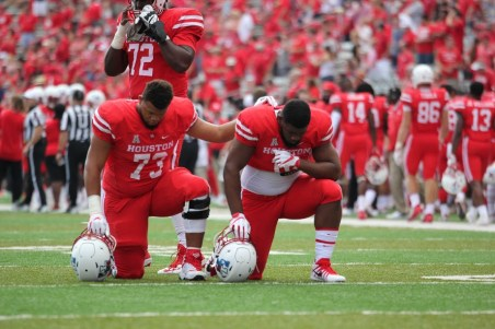 Oliver brothers, Marcus (left) and Ed (right), share a moment prior to taking on the Texas Tech Red Raiders on Saturday. Houston entered the matchup with a seven-game winning streak against Power Five Conference teams.   Thomas Dwyer/The Cougar
