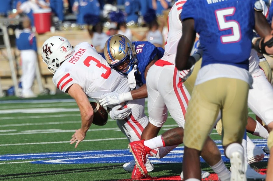 The normally elusive junior quarterback Kyle Postma was sacked a total of three times by the Tulsa defense, setting the Cougars back 32 yards in all. Cougar QBs have been sacked just seven times all season. | Thomas Dwyer/The Cougar