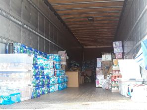At 6 p.m. near the closing of the drive, people started to get off work and came by to drop off water, canned goods, diapers and other supplies. | Trenton Whiting/The Cougar