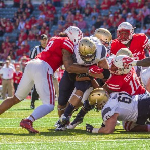 With the game tied 7-7, Navy tried to go for it on fourth down at Houston's two-yard line to take the lead, but Houston held strong and stopped the runner.   Richard Fletcher Jr./The Cougar