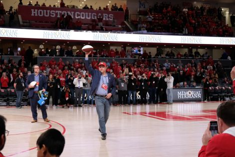 Head football coach Dana Holgorsen was introduced at halftime of the game versus Tulsa. He threw out a few signed footballs, gave a media interview and even signed a Red Bull. | Kathryn Lenihan/The Daily Cougar