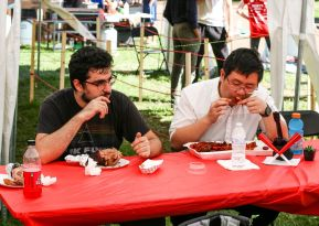 Sam Nader III (left) and retail and consumer science junior Lawrence Shen (right) chowed down on some crawfish and turkey legs during the festival. | Corbin Ayres/The Cougar.