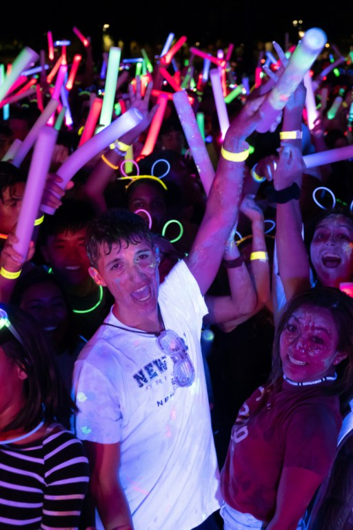 Freshman accounting major Ethan Newton joins the jubilance of the night, dancing and cheering, covered in paint and waving glow sticks. | Kathryn Lenihan/The Cougar