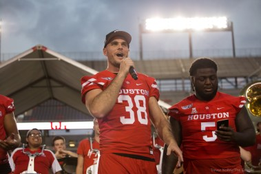 "UH Football Punter Dane Roy leads fans in singing ""happy birthday"" to D'eriq King. 