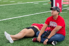 """Jennifer Mejia Rueda and Alfonso Rodriquez, are both UH alum who both majored in finance and graduated in 2018 and 2017, respectively. """"We're life members and young alumni, apart of the tailgating group. So, we tag along, got RedZone tickets. We're pretty accustomed to coming. They bring variety everytime, so it doesn't never get boring,"""" Mejia Rueda said."""