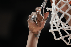 Hinton showed off his hardware as he cut down the net, flashing his Sweet Sixteen ring from Houston's 2019 run in the NCAA Tournament. | Mikol Kindle Jr./The Cougar