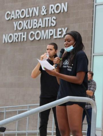"""Junior outside hitter Alexis Cheatum speaking to the crowd of fellow student-athletes, coaches and family. """"If anything, I think we are using our platform to make positive momentum,"""" she told reporters before the march officially began. 