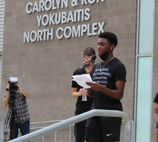 Junior sprinter Frederick Lewis during the opening round of speeches before the march around campus began on Saturday. | Donna Keeya/The Cougar