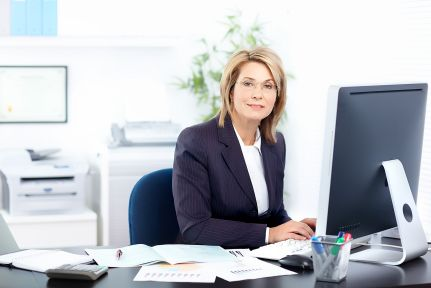 8255683 - pretty business woman working in the office
