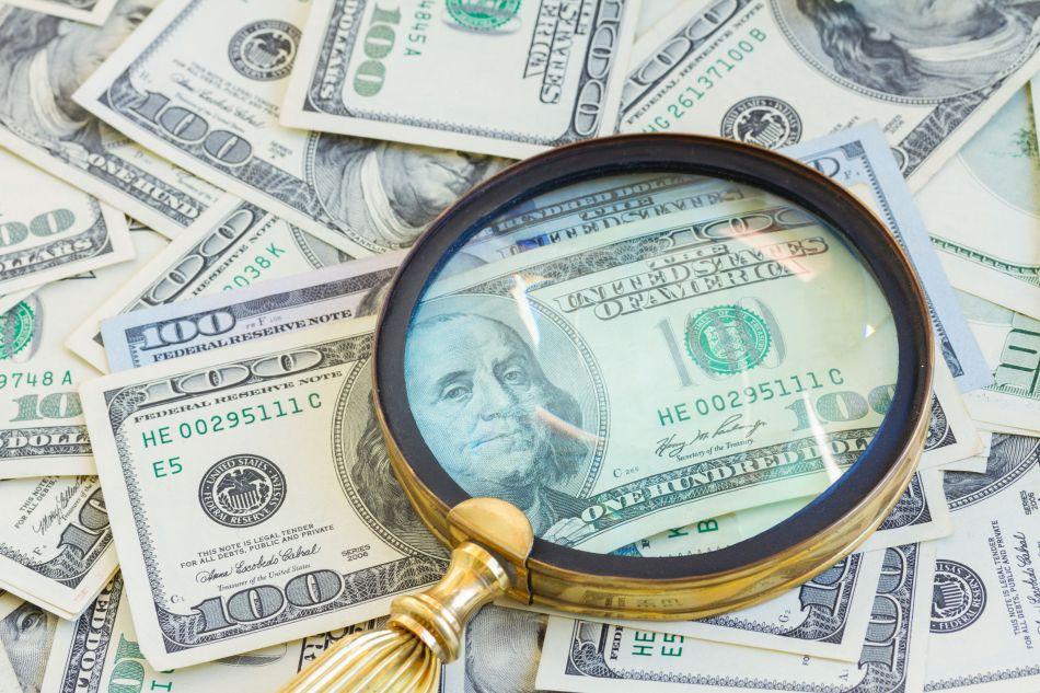 38851798 - money under manifying glass